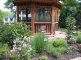 Gardens - The Steamboat House in Galena IL is set amidst lovely gardens and features a huge front porch with rockers and swing plus a screened gazebo.