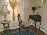 Collinwood Inn - The Josette Room - The Josette Room features a romantic Queen canopy bed, antique French writing desk, and a private bath with shower. Ghostly apparitions at no extra charge.