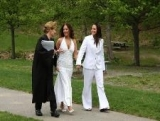 Reverend Sara & Couple Walking to Ceremony Site
