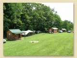 Another view of cabins and tents at Stag Run Club