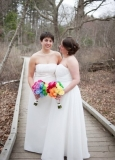 Katie & Alyssa - Katie and Alyssa decided to do rainbow bridal bouquets. Each of their bridesmaids had one color of the rainbow.