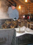 Scott making maple syrup - We have a working maple syrup farm with 2500 taps and proudly make syrup over a wood fire in the spring...and offer guided tours the rest of the year.