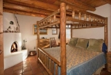 Artists Road A - The Artist A bedroom features a hand-carved antique king size Mexican bed.