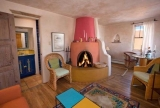 Kiva - Lovely Mexican folk paintings and tile throughout the house. Vigas and a grand Kiva fireplace grace the living room.