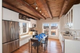 El Caminito - A gourmet kitchen, with granite counter tops, high end appliances and a large dining room table.