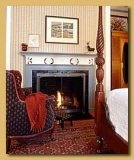 Emerson Room - Four-poster Queen bed, gaslog fireplace, bay window and bubble jet tub.