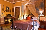 The Safari Room - The most exotic room in the house, which showcases collections of travels from the proprietors. This room has its own private entrance off the back porch of the main house, with sitting area under the wisteria arbor. There is a queen sized bed and the rustic bathroom includes an antique claw foot tub and hand held shower. For the dog lovers, this room is dog friendly and includes a dog bed and foo