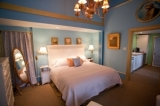 The Cottage Suite - The beautifully decorated Cottage Suite is a room you are sure to get some rest and relaxation in. This suite is painted in cool blue tones, complete with King Size bed, private bath, and kitchenette. The Cottage Suite has its own private entrance, as well as a private patio area and fish pond. Need as place for man/woman's best friend? You are in luck because this room is one of two that is dog f