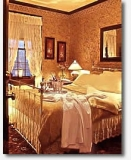 bed-10-wine-2 - Gold Rush hotel room #10
