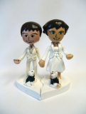 Cake Topper - A custom cake topper based on the Nintendo Wii.  The figures are based off of the couple's own avatars.