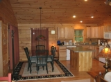 Kitchen and Dining area are great for eating in. - Full kitchen utensils and appliances provided. There is an electric grill on the porch facing the creek.