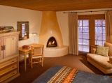 Deluxe King Accommodations - With patios or balconies and kiva-style fireplaces or sofa seating, our deluxe Rooms offer ample space in which to relax.