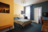 A standard room with a queen size bed - Spacious and bright rooms, the perfect choice for either relaxation or business.