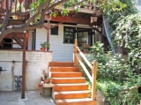 Silverlake Cottage LA (Garden Cottage #1) - Yard entrance to Silverlake Cottage #1== a garden view of pond, fruit trees, with terraced patios, firepit, BBQ. Queen loft bed, pillow top twin, WiFi, kitchenette, washer/dryer in walking of all Silver Lake, minutes to downtown and Hollywood, WeHo close. See silverlakecottagela.com, please.