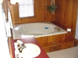 Suite 4 jacuzzi tub - Queen canopy bed, gas fireplace, 2 person jacuzzi bath in the attached private bathroom.