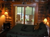 Duck room - Duck decoys, duck calls, duck photos, and other duck stuff. You'll find them all in the cozy Duck Room which features a queen size bed, wood floors, oriental rug, tongue-and-groove cedar walls, and exposed beams. The new sliding door leads to a private screened-in porch, perfect for quiet reading or late night wine & cheese. A bathroom with tub/shower is en suite, and is decorated with duck scenes