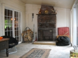 Enclosed Porch with Fireplace - Very pleasant glassed-in porch, with a cozy wood-burning fireplace.