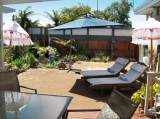 Garden/courtyard - Sunny, private, clothing optional outdoor area with sun-loungers and sun umbrella.
