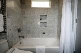 Room 1 Bath. - Bathtub, rain shower, electric toilet/bidet, towel warmer.