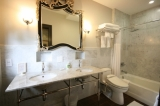 Room 9 Bath - Bathtub with rain shower, double vanity, electric toilet/bidet.