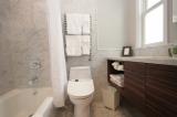 Room 16 Bath - Marble lined bathroom - bathtub with rain shower, towel warmer, electric washlet/bidet.