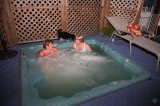 Hot Tub Open All Year - At Bewitched & Bedazzled our guests share the cozy compound, where they are able to enjoy each unique property. We have a wonderful 4000 square foot private deck with a sunken outdoor hot tub that is open all year round. We also have a beautiful, well lit garden area, complete with a doggie park area and a cozy double swing that our guests and their dogs can enjoy.