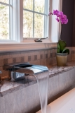 Waterfall Faucet - A waterfall faucet is a wonderful finishing touch to a decadent master bath.