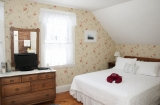 Daisy Room - Overlooking the garden, this room has both queen and full-size beds. The two east-facing windows are perfect for enjoying the morning sun.<br /><br />Occupants: 4<br />Smoking: No<br /><br />RATES:<br />Summer (May 16-October 31): $159.00<br />Early Winter (November 1-December 31): $149.00<br />Winter (January 1-May 15): $139.00