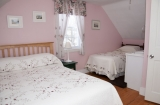 Forget-Me-Not Suite - This room can be expanded to accommodate five people with two queen beds and a twin, and has its own private bath. This room includes the Forget-Me-Not room.<br /><br />Occupants: 5<br />Smoking: No<br /><br />RATES:<br />Summer (May 16-October 31): $239.00<br />Early Winter (November 1-December 31): $219.00<br />Winter (January 1-May 15): $199.00