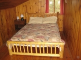 Bedroom - Typical bedroom with pine log double bed