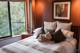 Tree Top Queen Room - The Tree Top room is the place where you can relax after a busy day at the beach or at the many attractions Albany has to offer. Your bedroom has a private tree top deck from where you can watch the many variety of birds play and eat in the bird haven below.