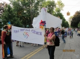 """Inclusion Man"" - Our pastor wearing our rainbow flag in the  Ithaca Festival Parade!"