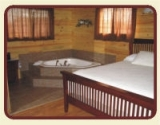One Bedroom Jacuzzi - 2 person, corner Jacuzzi tub situated in the masterbedroom of this beautiful one bedroom suite.
