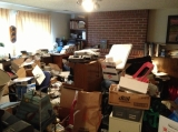 "August 2013 - The ""before"" photo of the basement of a person with hoarding disorder. I was part of a team of five organizers who volunteered to clear this space. It took four hours."