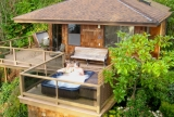 The cottage is like a treehouse with its own hot tub, totally private