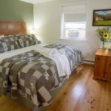 """Annapolis Suite (King) - This ground-floor premium suite is located in the farmhouse carriage house.  This unique 2-room suite features a bedroom with a king-size bed, the adjoining room is a spacious living room with a double pull-out sofa bed.  This suite has a refrigerator, 42"""" TV and a cozy gas fireplace.  The private ensuite includes a luxurious walk-in shower.<br /><br />Complementary Wi-fi"""