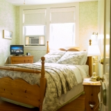 Apple Blossom Room - This lovely room is located in the main-house on the second floor.  It is beautifully decorated in apple green and features a queen-size cannonball pine bed, ceiling fan, dresser, TV, a small desk and comfy chair. The ensuite bathroom features a walk-in glass shower. <br /><br />Complimentary Wi-fi