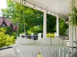 Front Porch - We have 2 separate swings on the front porch for you to enjoy during your stay.<br /><br />Complementary Wifi