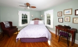 Warn House - Queen Room - Queen Deluxe, Sleeps 2 <br /><br />This stately room with a queen bed is comfortable and spacious – Ample space for a yoga mat or just relax in the wing-back chair with a good book.