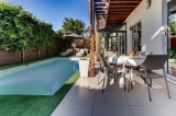 Soak up the sun around the solar heated pool and jacuzzi.