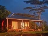 Mahi Oli'Oli at Sunrise - Warm glow of rising sun over the pacific bathes the eastern facade