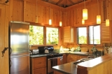 Kitchen - for serious cooks.   Custom Cherry cabinets, stylish euro energy smart fridge, gourmet tools, pans, service for eight