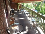 Patio Seating - Not only do we have creekside seating, but we have a deck that is open year round.  Enjoy the view if the creek side canopy.