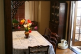Dining Room - Our elegant dining room seats six guests from Rose, Iris, and Lily. A hot, delicious breakfast is served on antique china. Lots of interesting conversations over our private blend of coffee!