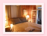 Rouleauville Room - Queen size bed with ensuite bathroom and a small sitting area