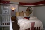 Room 6 Loft - Room 6's sleeping loft, with the Crescent City iron bed.